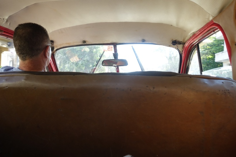 Sitting the backseat.