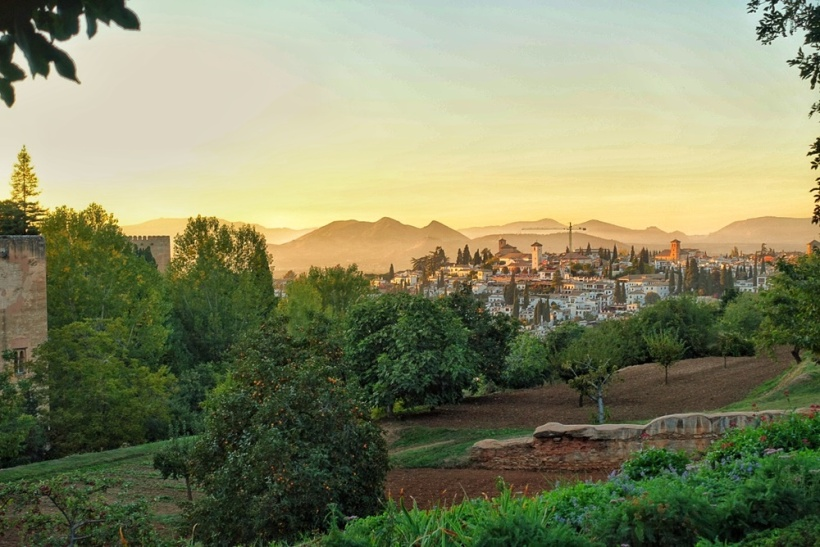 Granada, Spain at sunset from the Alhambra gardens.